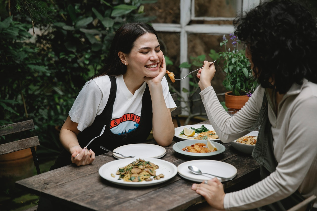women eating together