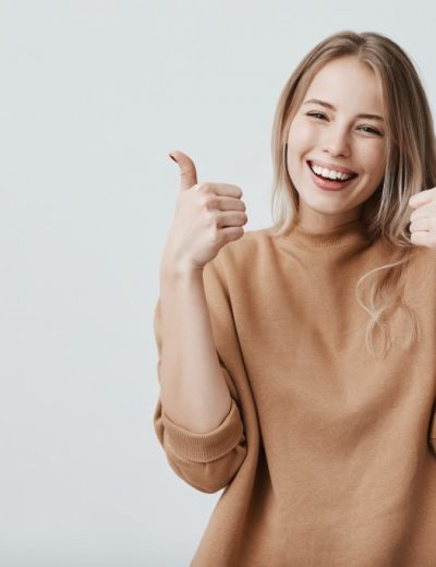 happy woman giving thumbs-up